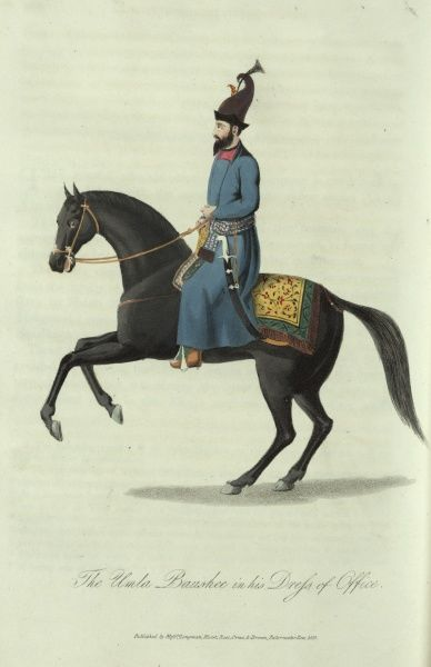 The Umla Baushee in his Dress of Office. A 19th century Afghan government official in uniform, riding a horse