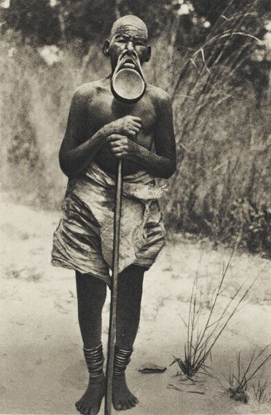 An African man from the Zambezi region in Africa, with an extraordinary lip plate, haning from the top of his mouth below his chin