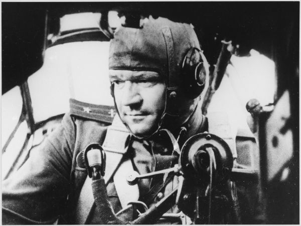Soviet Air Force Major in the cabin of his plane, maintaining contact with the ground forces