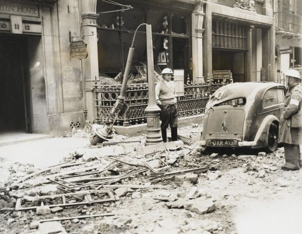 Air Raid damage off Piccadilly, London on 19th September 1940. A lampost and parked car have been heavily damaged by falling masonry from bombed buildings
