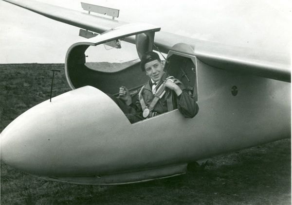 An Air Scout sits smiling in the cockpit of a glider at Lasham Gliding Centre