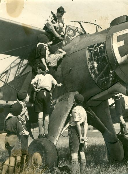 Air Scouts climbing on a Fairey Albacore plane with Lieutenant/Sir Laurence Olivier