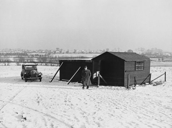 Aircraft Observer Post, during World War II. A hut houses two men comfortably, with one on duty and one off, but gets cold in winter