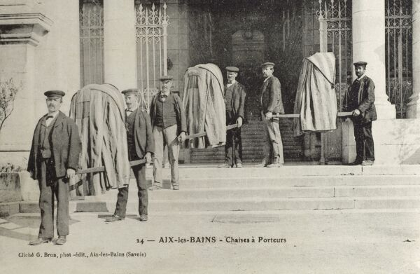 Aix les Bains, France - Porters with Sedan Chairs (Covered Litters), complete with viewing holes, in order to protect the modesty of the under-dressed spa visitor! Date: circa 1910s