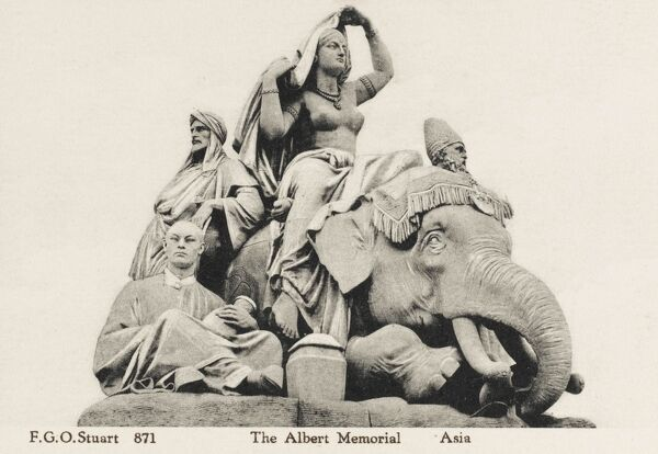 The Albert Memorial, Hyde Park, London - Statue detail (2 of 2) depicting 'Asia', including a semi-naked Indian woman sitting astride an elephant and a seated Chinese merchant