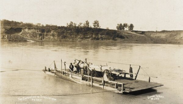 Alberta, Canada - The Edmonton to Strathcona Cable Ferry - bearing a horse and cart and a large amount of cut timber