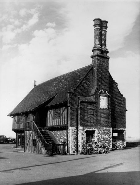 Aldburgh Moot Hall, a fine red brick and timbered building, which was once in the centre of this quaint Suffolk town, before coastal erosion caused it to be close to the sea. Date: 16th century