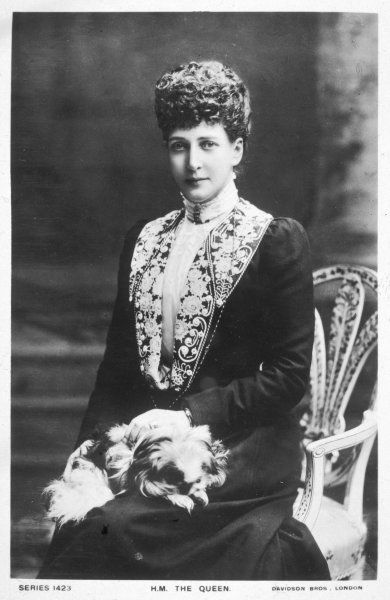 Alexandra, queen of Edward VII, is used to posing for her portrait - but no more so than her well-behaved little dog, a Japanese Chin