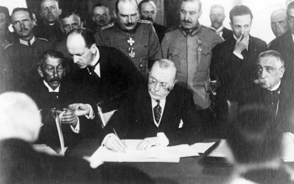 Alexandru Marghiloman (1854-1925), Romanian Prime Minister, signing a Peace Treaty (known as the Treaty of Bucharest) with Germany and Austria in the Cotroceni Palace, near Bucharest. The Treaty was nullified by the terms of the Armistice of 11 November 1918