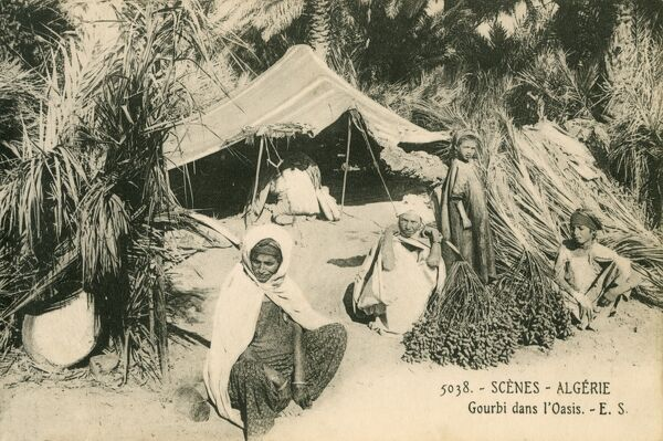 Algeria - Gourbi Tent and occupants at a desert oasis