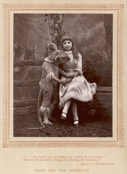 Isa Bowman as Alice and Emmie Bowman as the Dormouse, in a stage production