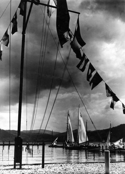Ominous clouds looming over the Altersee Regatta, Austria. Date: 1930s