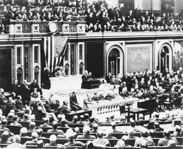President Woodrow Wilson declares America at war with Germany, to a joint session of Congress in 1917