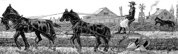 The plough is pulled by a team of four horses, the warehouses and wooded framed farmhouse can be seen in the background