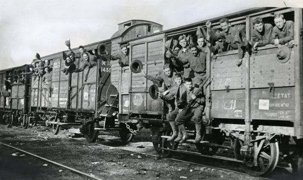 American 5th Marines travelling on a troop train soon after arriving in France during the First World War. Several of them are waving to the camera. Date: June 1917