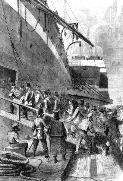 Soldiers in full uniform marching up the gangplank of the troop carrier, the 'Great Eastern', with the docks of Liverpool in the background