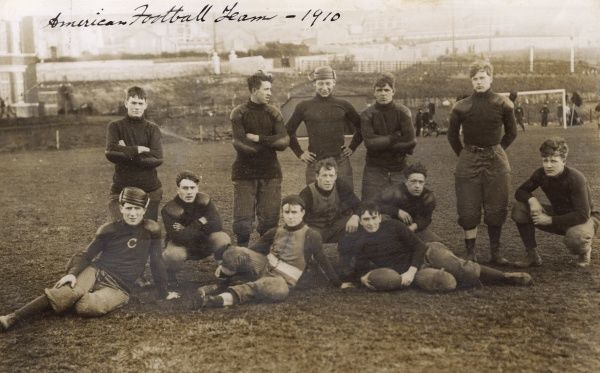 American Football Team Photo - possibly a British-based team as they appear to be playing on a football (soccer!) pitch. Date: 1910