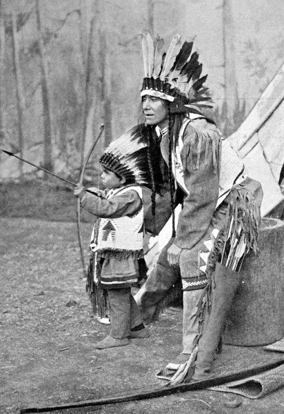 American Indian father and son with bows and arrows