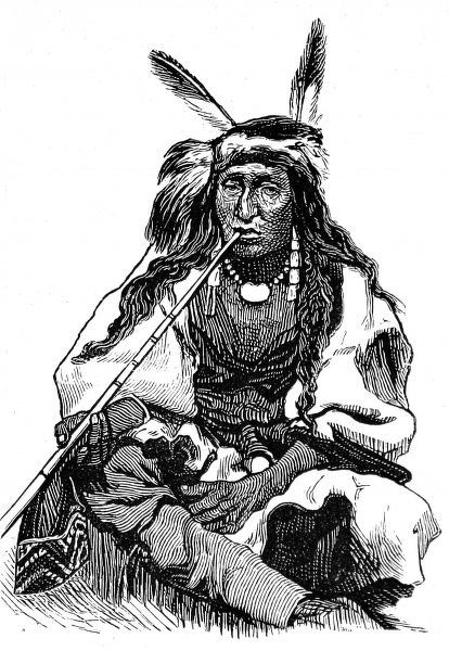 Indian Chief smoking a long pipe wearing beads and feathered headdress