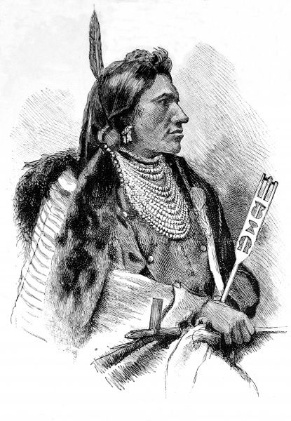 Sioux Chief wearing beads and carrying a pipe