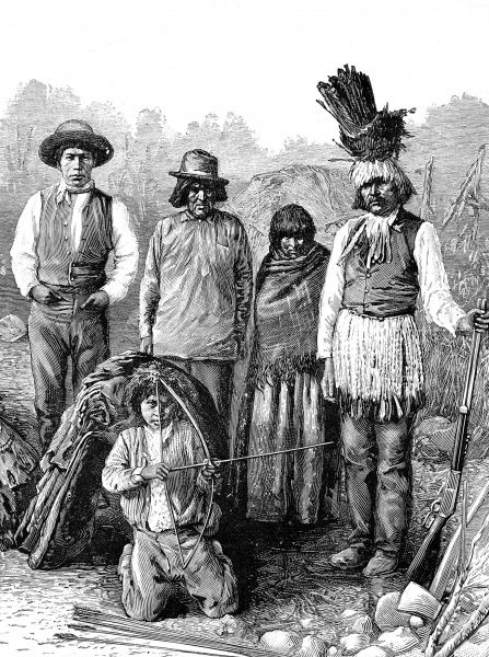 Group of American Indians in a mixture of traditional and European dress, boy in foreground holding a bow and arrow, on the right the Chief in feathered head dress holding a rifle
