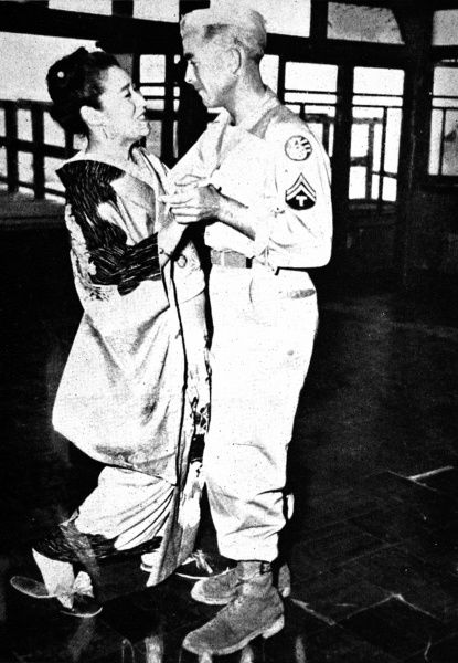 Photograph showing an American serviceman dancing with a Japanese Geisha in a Tokyo Geisha House, shortly after the end of the Second World War, October 1945
