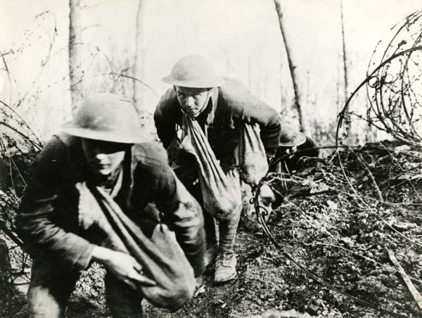 American soldiers going into action near Badonviller, north eastern France, during the First World War. Date: 17 March 1918