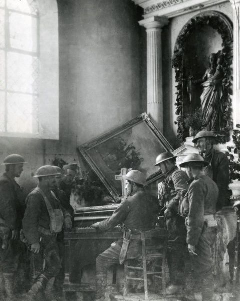 American troops in a ruined church in Exermont, north eastern France, during the First World War. Date: 1918