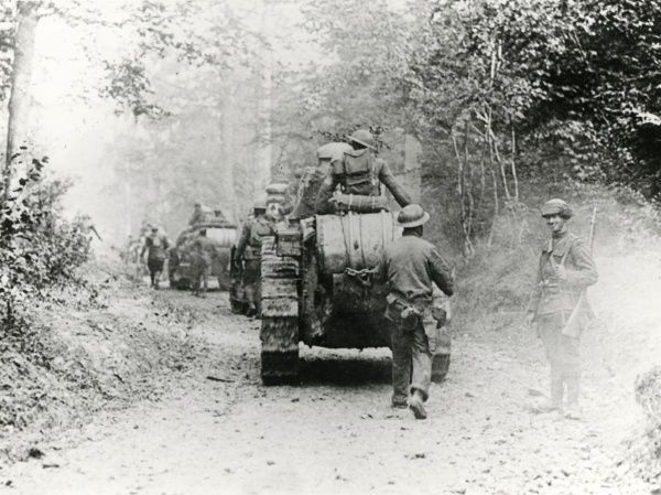 American troops and tanks of the 326th Battalion, 311th Tank Center, moving up to a forward area near 35th Division headquarters, Boureuilles, north eastern France, during the First World War