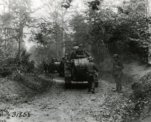 American troops and tanks of the 326th Battalion, 311th Tank Center, moving up to a forward area near 35th Division headquarters, Boureuilles, north eastern France, during the First World War. Date: 26 September 1918