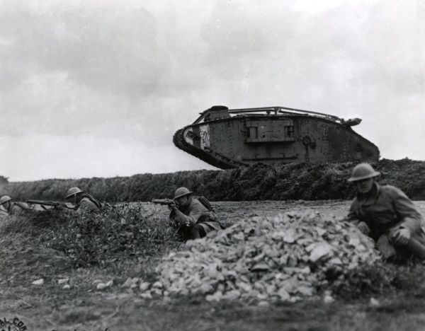 American troops of the 107th Infantry Regiment, 27th Division, training with tanks near Beauquesne, Somme, northern France, during the First World War