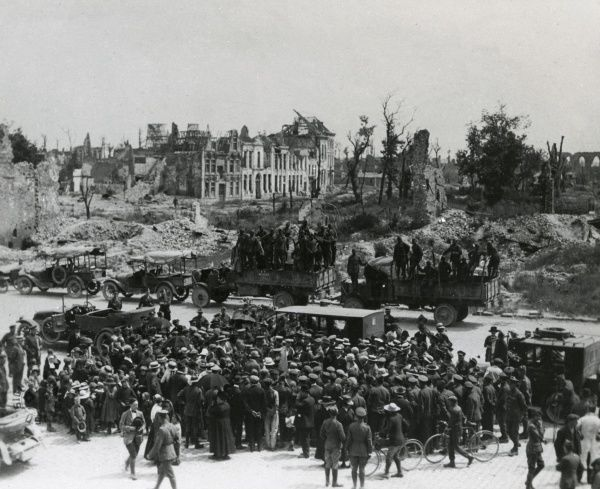 American troops and transport on a road in war-torn France during the First World War. Date: 1917-1918