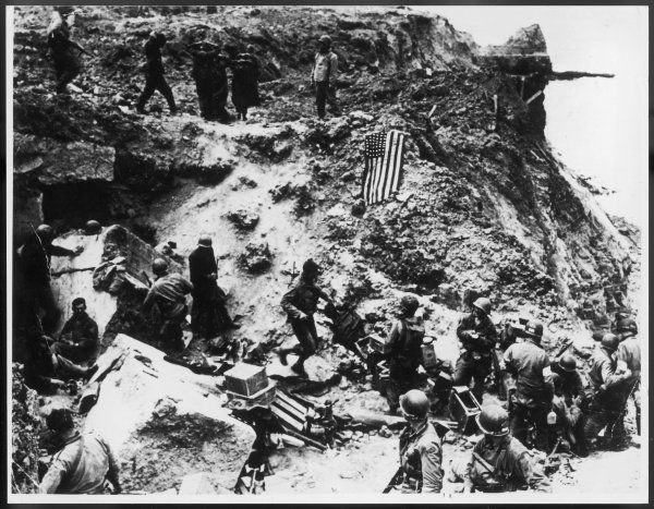 American troops and their German prisoners on Omaha Beach, Normandy, France