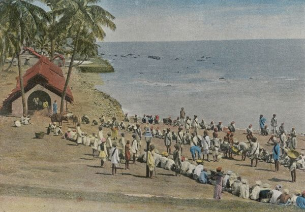 Prisoners take their meals on the beach in the Andaman Islands