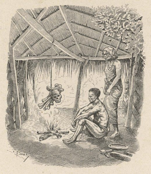 Natives of the Andaman Islands dry the bones of their parents over a fire inside a hut