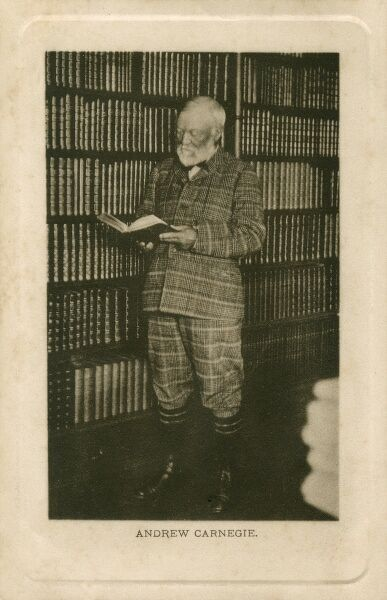 Andrew Carnegie (1835 - 1919) reading in front of a rather splendid bookcase, almost camouflaged by his full tartan suit!