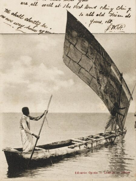 Traditional boat carved whole from the trunk of a tree - on the sea off Luanda, Angola, south-west Africa