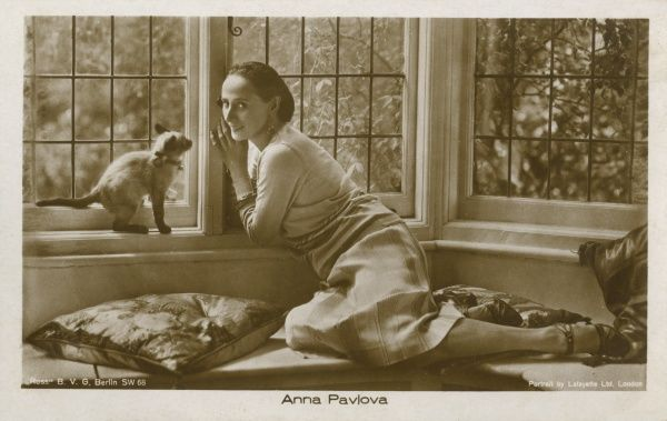 ANNA PAVLOVA Russian ballet dancer in her London home with her cat