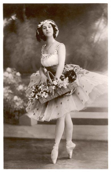 ANNA PAVLOVA Russian ballet dancer holding a basket of flowers during a performance