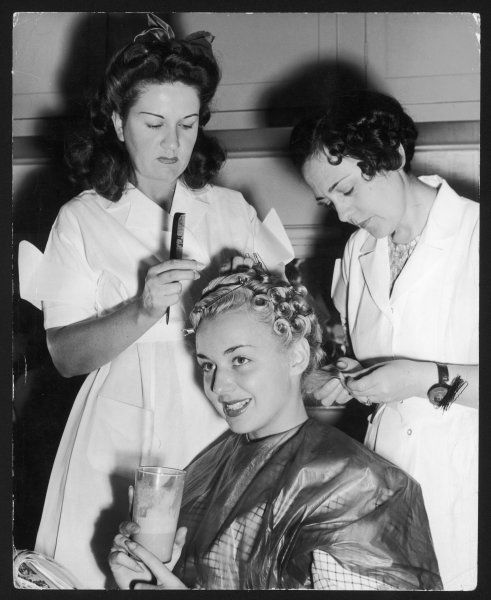 Anne Shirley gets a new hair- do for the film 'Bombardier'. Her blonde hair is curled and held in place with hair grips