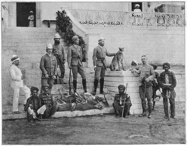 A group of European hunters, with their Indian helpers, stand with the antelopes which their cheetah has caught for them