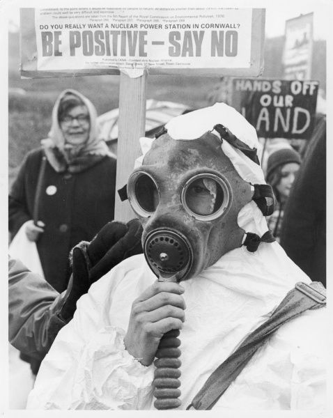 A anti-nuclear protester, wearing a gas mask and white protective suit, campaigns against nuclear power in Camborne, Cornwall