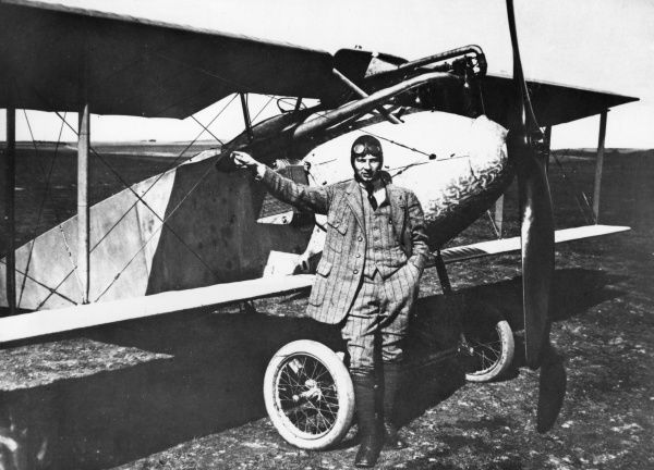 Anton Herman Gerard (Anthony) Fokker (1890-1939), Dutch aviation pioneer and aircraft manufacturer, famous for the fighter aircraft he produced in Germany during the First World War. Seen here standing in front of one of his planes. Date: 1914-1918