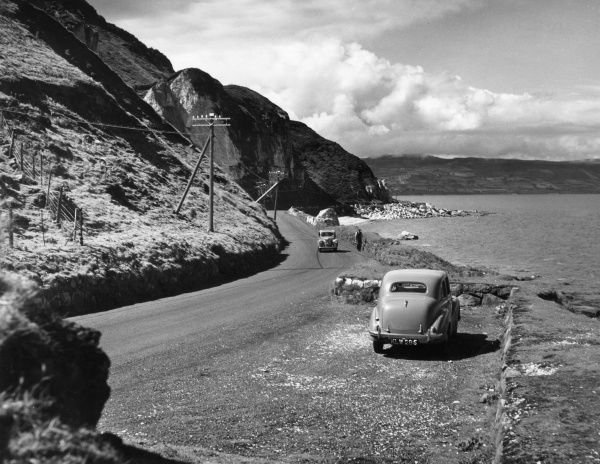 Part of the rugged Antrim coast, Northern Ireland, along which for over 40 miles runs the famous coast road. Date: 1960s