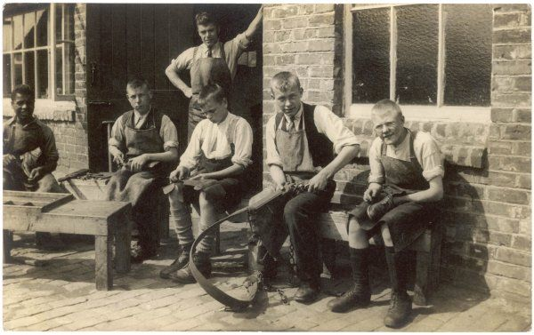 A group of apprentices learning various tasks in a rural setting