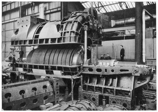 'AQUITANIA' One of the engines of the Aquitania being lowered into position during its construction