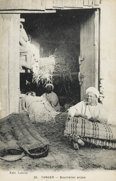 Stuffing Mattresses with straw - Tangiers, Morocco Date: circa 1910s