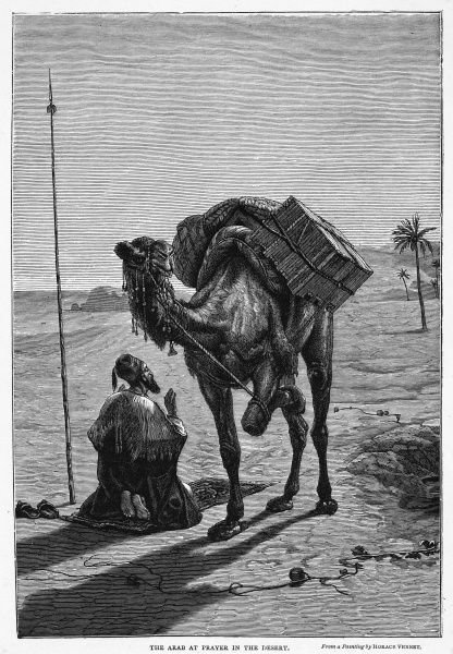 An Arab traveler hobbles his camel while he pauses in his journey to turn towards Mecca and perform his midday prayers