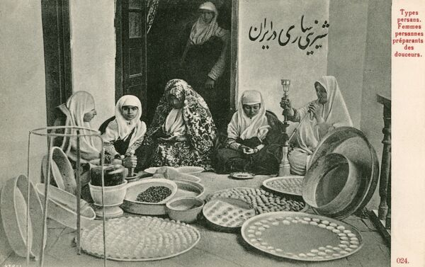 Arab women preparing trays of sweetmeatsm or Baklava in Iran