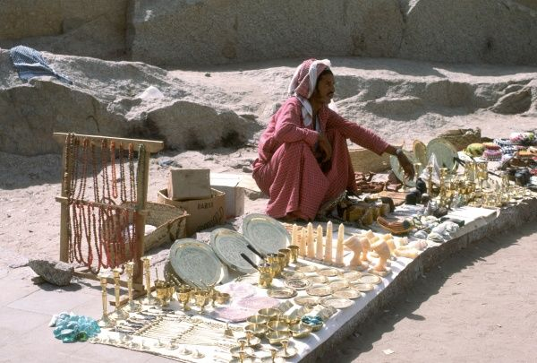 Arabic seller of cheap souvenirs, Aswan, Egypt. Photograph by Lionel Coates